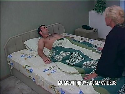 Blonde Mature Waking Stepson With A Blowjob