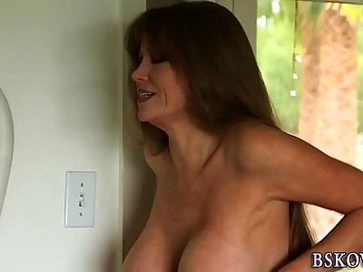 Busty milf gets facial